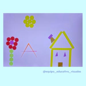 Dibujo de un arbol, una casa y un sol en la mesa de luz